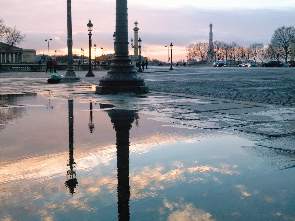 Reflection of Place de la Concorde in a puddle