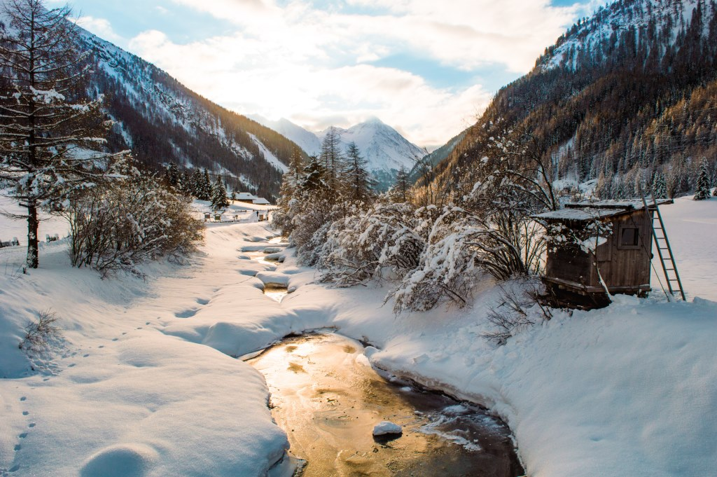 Snowy landscape with a frozen brook in Hohe Tauern National Park