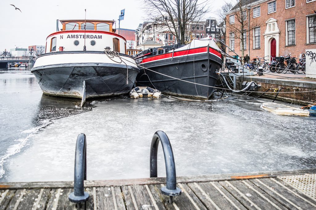 Icy-cold winter in Amterdam with frozen harbours