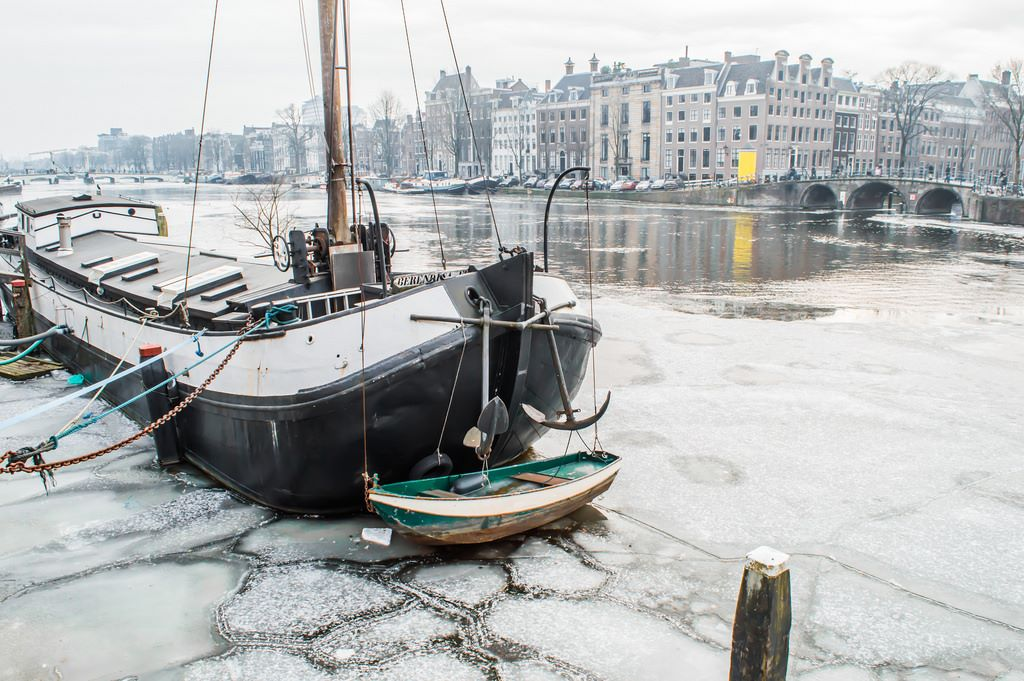 Ship in frozen water in Amsterdam