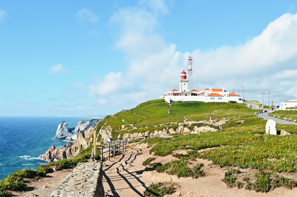 Cabo da Roca on a sunny day, with the white and red lighthouse in the distance