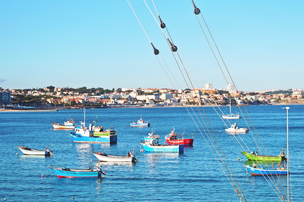 Several boats float in the harbor of Cascais, Portugal