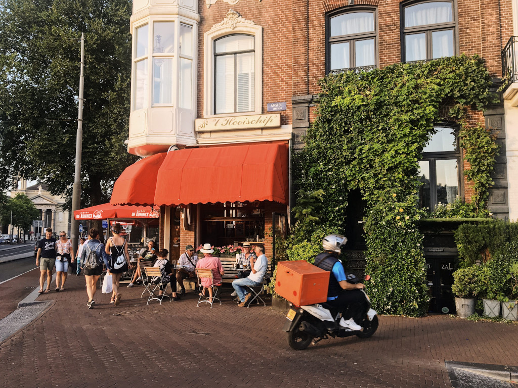Drinks and conversations at the sidewalk cafes in Amsterdam
