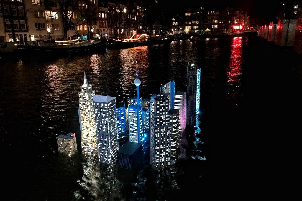 Amsterdam Light Festival in 2019-2020 (Atlants: a collection of iconic buildings from around the world are in the canal as a statement about climate change)