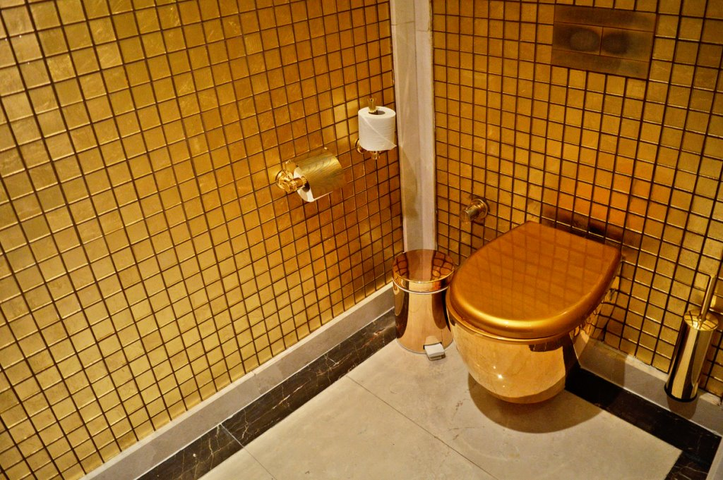 Golden toilet at a fancy hotel