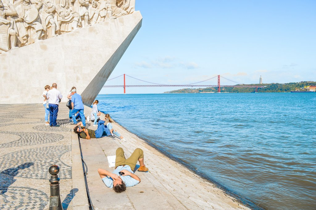 Enjoying the sun on the banks of the Tagus River in Lisbon.
