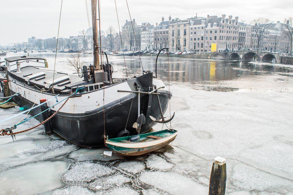 Ship in frozen water in Amsterdam