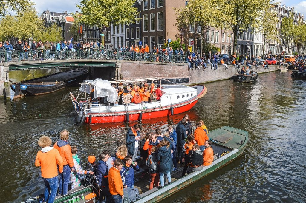 King's Day on the canals in Amsterdam
