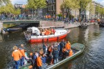 King's Day in Amsterdam, celebrating on the historic canals