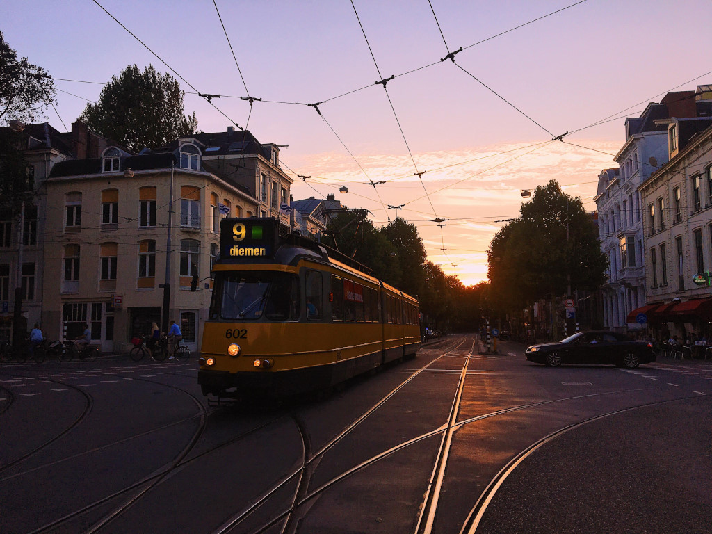 The sunset sets in while a tram to Diemen cruises the streets of Amsterdam