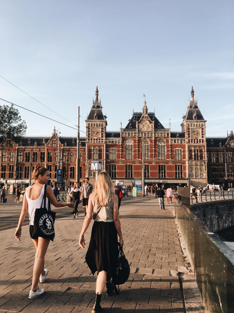 Two friends make their way to Amsterdam central station