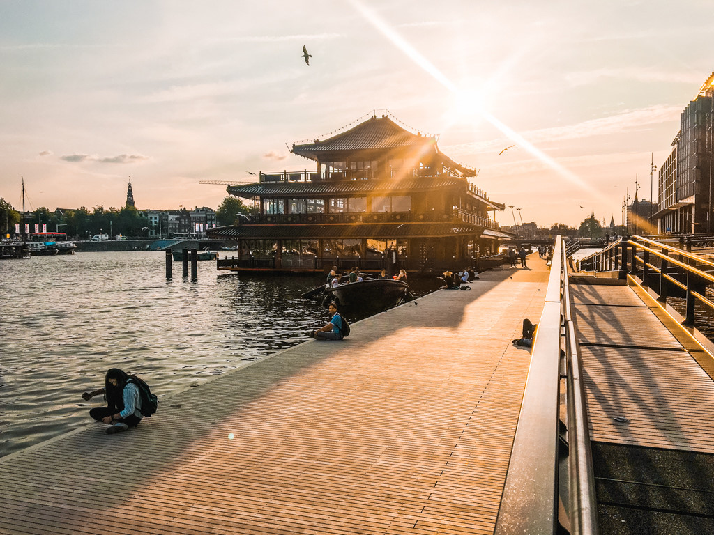 The sunset paints the Oosterdok boardwalk in Amsterdam golden