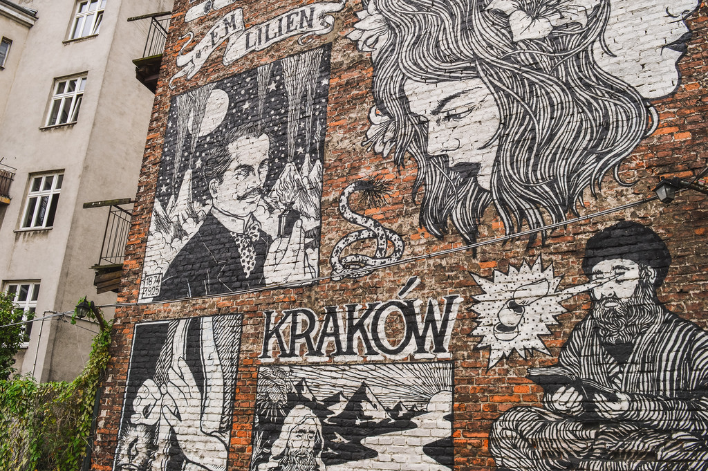 A black and white street art mural in Krakau, Poland.