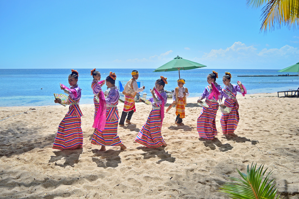 Traditional dancers on Cemara Beach, Wakatobi.