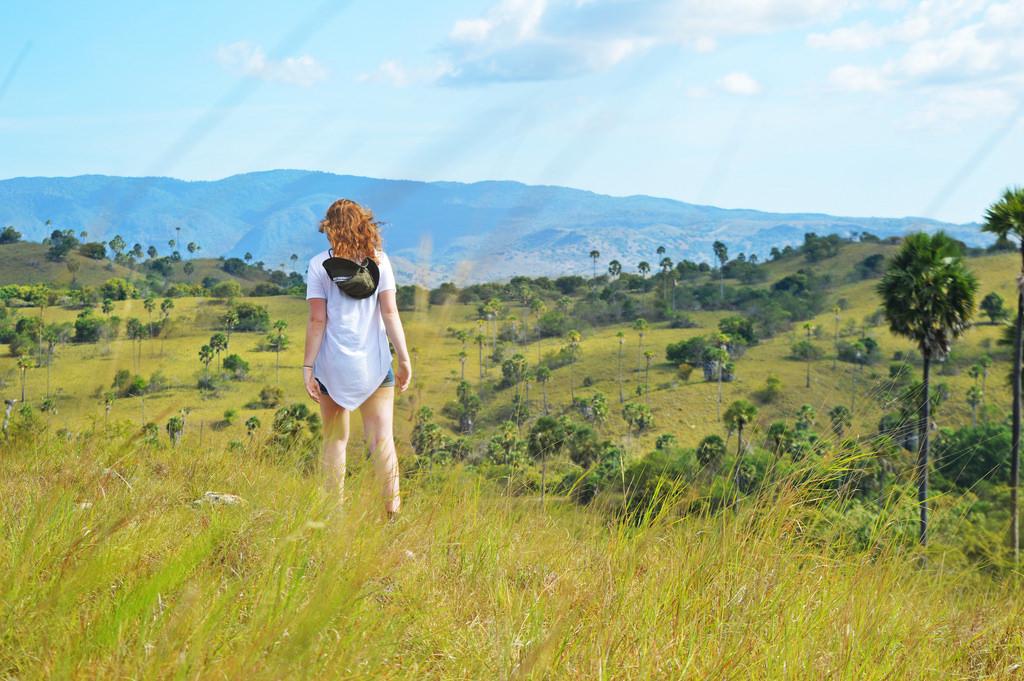 Komodo Islands in Indonesia: Roselinde walking in a field on Padar Island