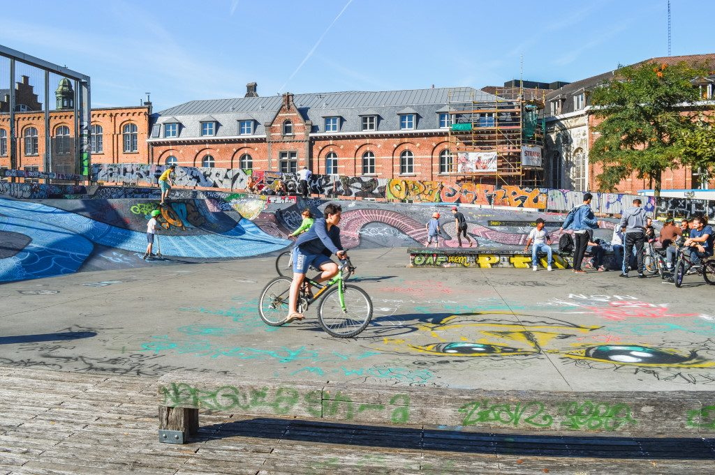 Kids skating and cycling at a colourful skate park in Brussels