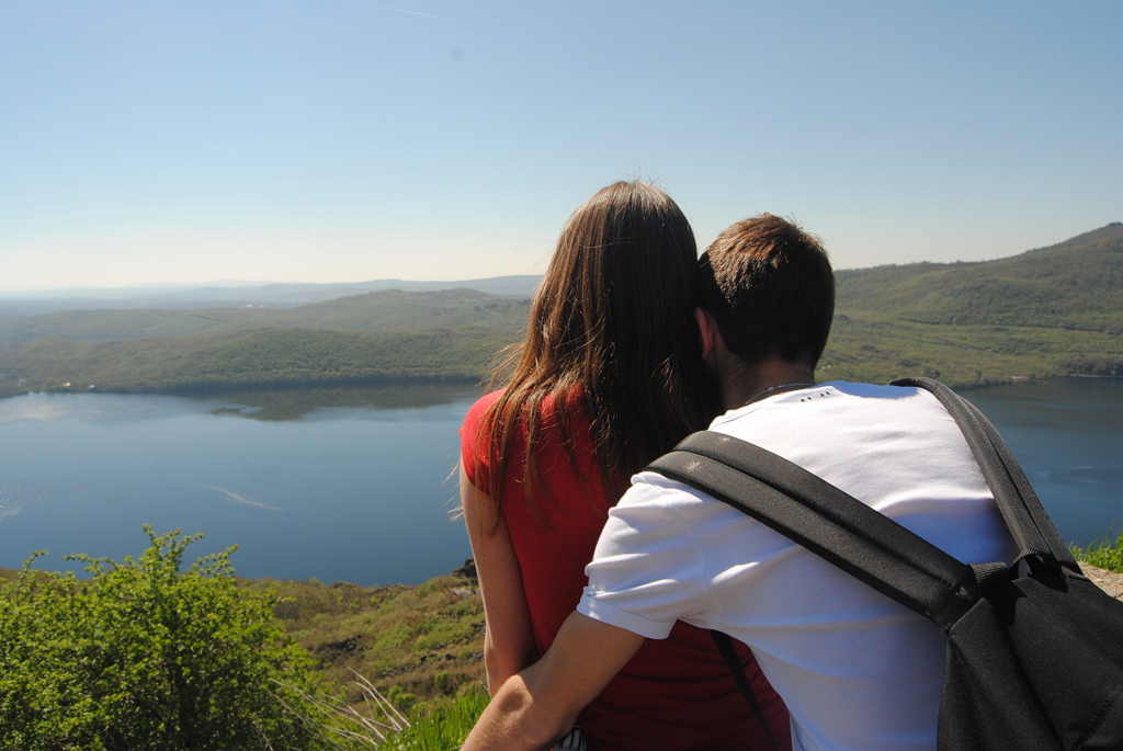 A couple looks at Sanabria Lake