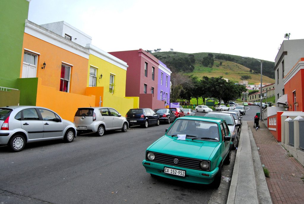 Cars, including a vintage one, on the streets in the Bo-Kaap