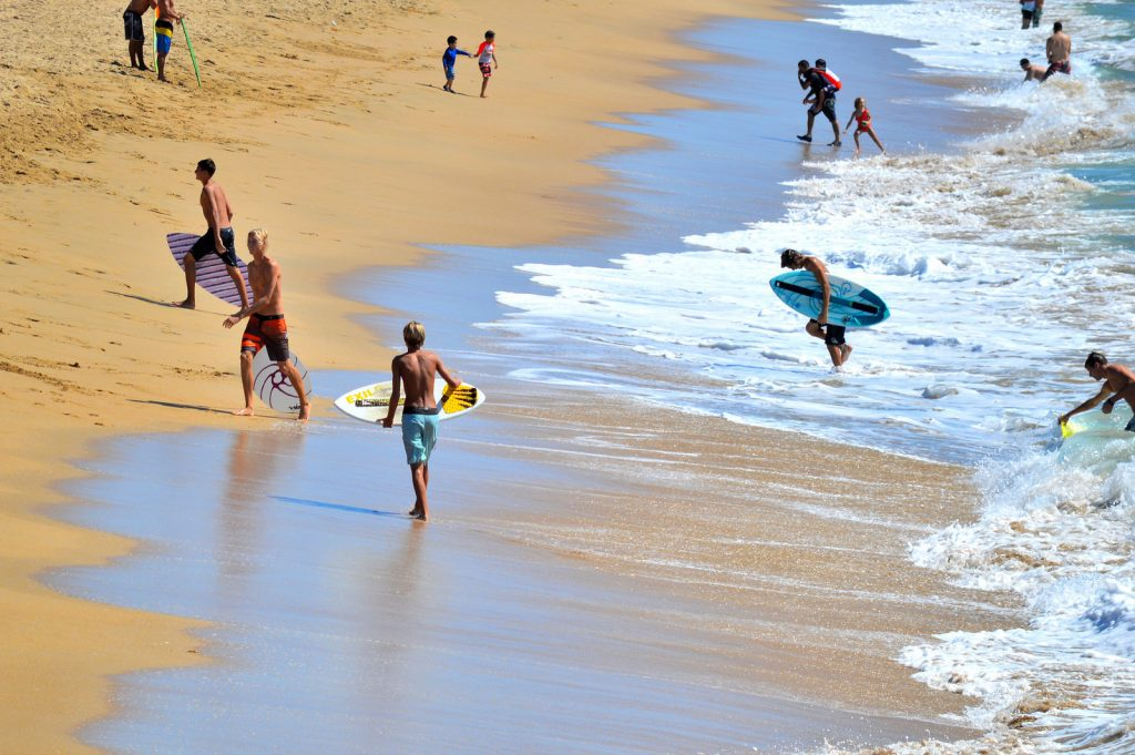 Surfers at Huntington Beach in California