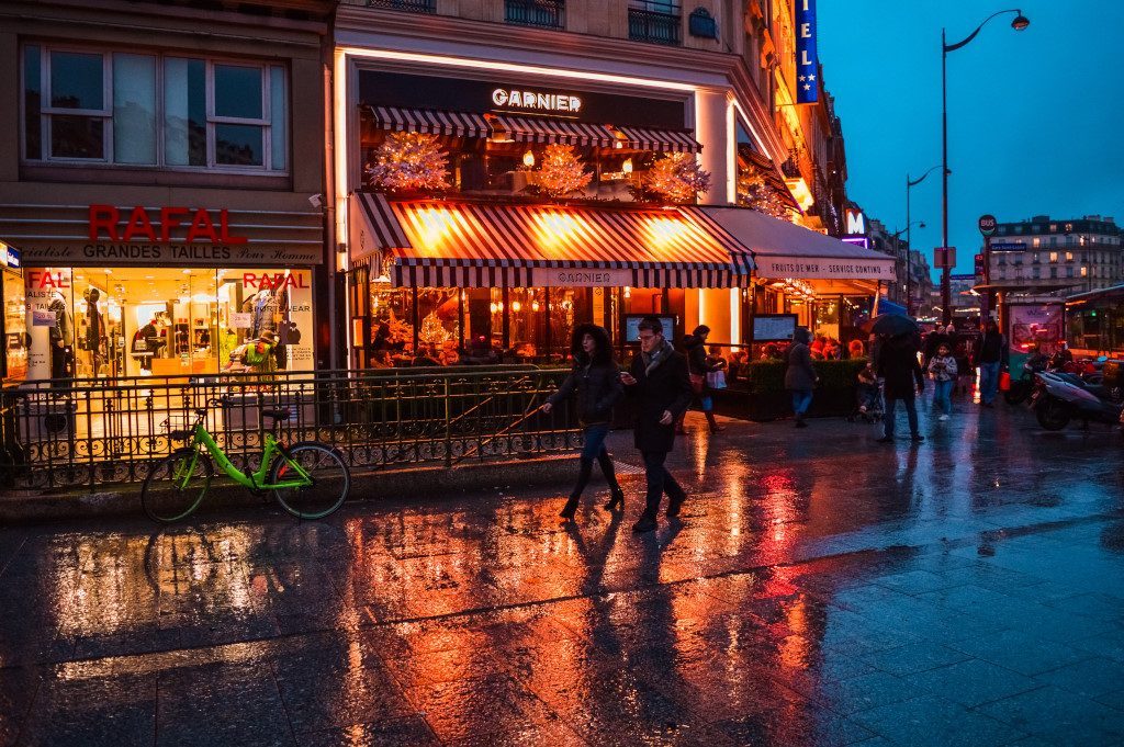 Streets of Paris by night on a rainy evening