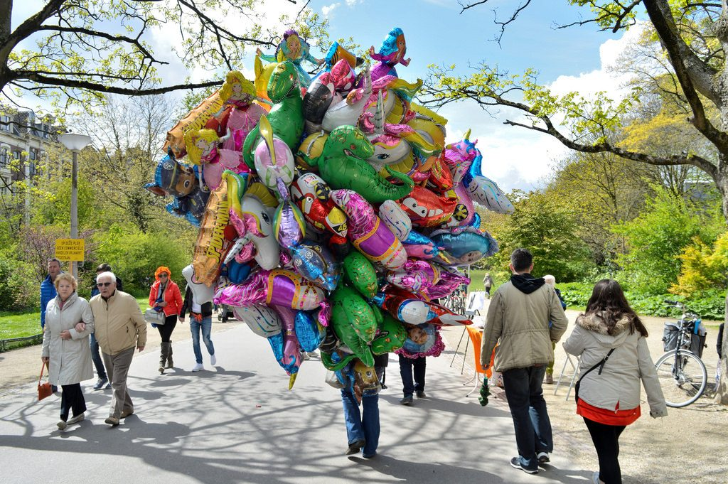 King's day at Vondelpark: a man selling balloons is completely hidden behind his balloons