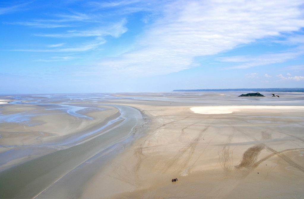The beach at Mont Saint-Michel on a sunny day