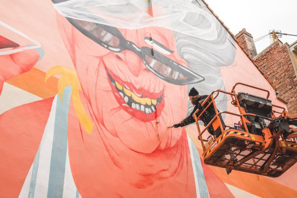 A colourful, orange and yellow mural in Ostend, part of The Crystal Ship festival