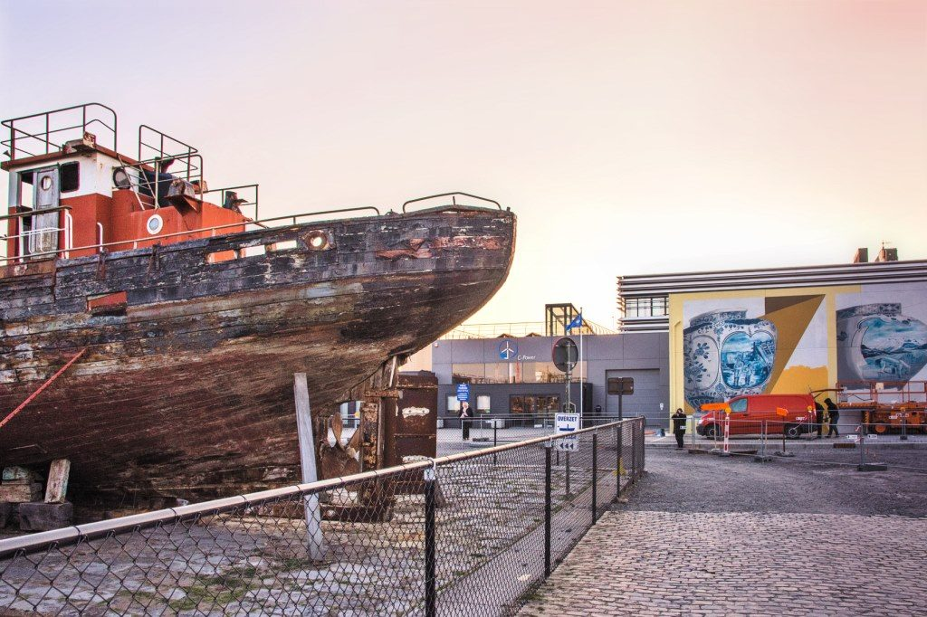 The old port in Ostend with a colourful mural in the background