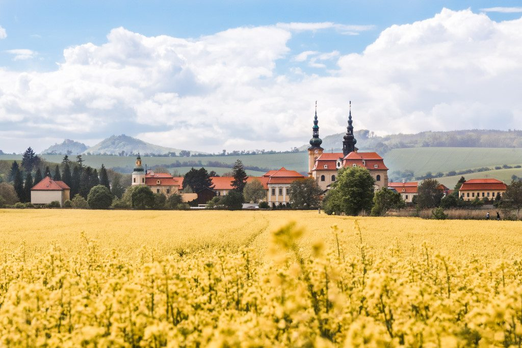 View of the village of Velehrad in Moravia with a rapeseed field in the forefront.