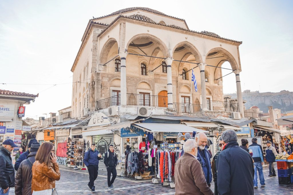 Historic buildings and people chatting on Monastiraki Square