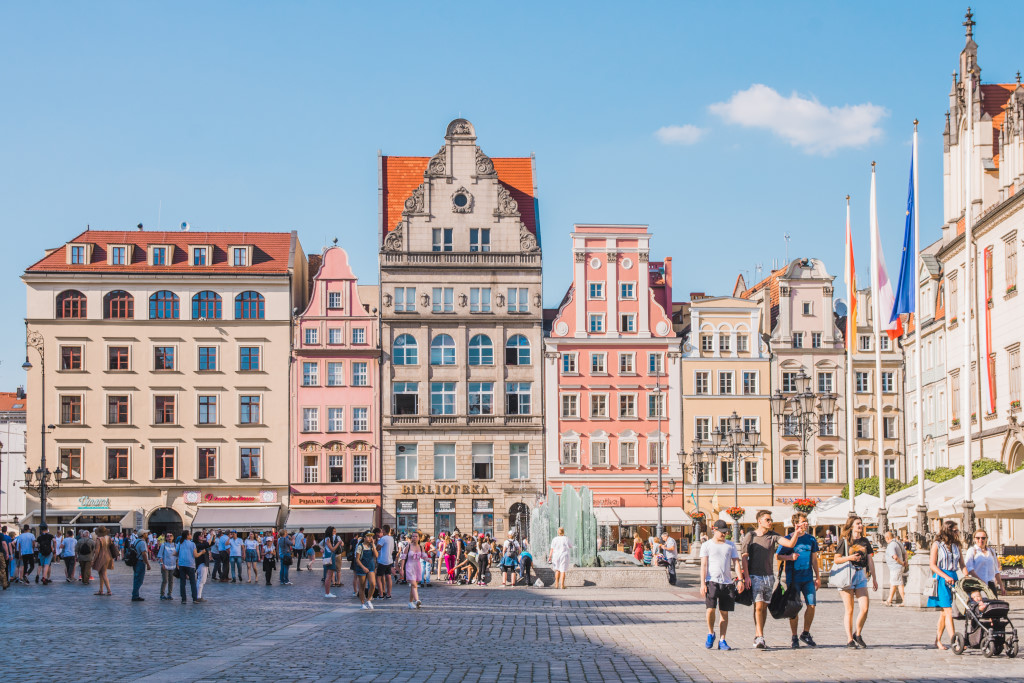 The main market square in Wroclaw (capital of Lower Silesia, Poland) with colourful and historic architecture, as well as groups of people walking around