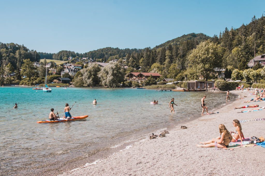Sunbathers and swimmers at Lake Fuschl, a great option for a day trip from Salzburg