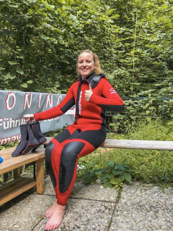 Roselinde poses in her wetsuit, before she enters the canyon in Salzburg